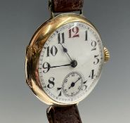 A 9ct gold trench wristwatch 32mm diameter London 1908 27.4gm with strap. Phillip Wadsworth. Died