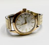 An Oris 17 jewel gentleman's date gold-plated wristwatch with sweep seconds 39mm diameterWinds and