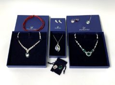 Swarovski Jewellery - Two boxed necklaces - one set with 'emerald' green and white crystals the