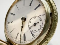 A large gold plated full-hunter cased pocket watch engraved to the front with a stag and there