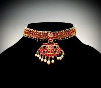 An impressive Ceylonese ruby and pearl necklace, the collar is formed with 68 crescent-shaped