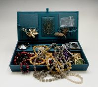 A quantity of costume jewellery, including a 9ct gold chain (2.5g) and some silver and nine