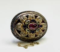 An early Victorian gold brooch set with a central pink gem within other gemstones 40mm 14.6gm