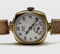 A Tissot ladies 9ct cased wristwatch movement no.932849 on 9ct gold bracelet 19.8gm excluding