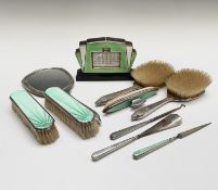 A silver and green enamel dressing table set - nine pieces, comprising of four brushes, a hand