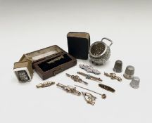 A miscellaneous lot with four gold brooches and a gold stick pin 9.1gm, a high purity Calcutta