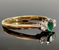 An 18ct gold ring set an emerald and two diamonds Condition: Needs a clean but settings secure and