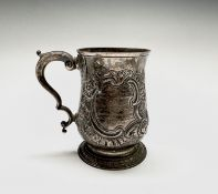 An early George III silver bellied mug by Joseph Steward London 1766, 11.15oz, 12cm. Repouse