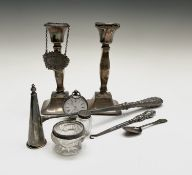 A silver keywind pocket watch, an 18th century small spoon, filled silver candlesticks, a William