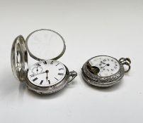 A Waltham engine-turned silver full-hunter cased pocket watch no.1,625605 Birmingham 1881 48.9mm,