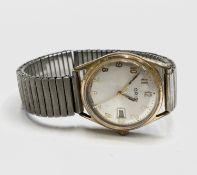 An Oris 7 jewel gentleman's date gold-plated wristwatch with sweep seconds 32.7mm diameterWinds