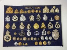 Police Forces - Foreign. A display card of Badges, Buttons and Shoulder Titles. Noted: Tonga Police,