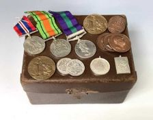 World War Two Trio of Medals and various Horticultural Medallions. Lot comprises a small gas mask?