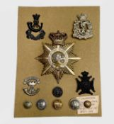 Shako Plate, Cap Badges and Buttons. A mainly 19th century card including South Devon Regiment of