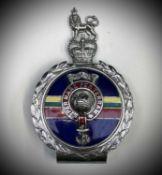Royal Marines Car Badge. A Yorkshire Tea tin containing: A Royal Marines Car Badge by J R Gaunt in