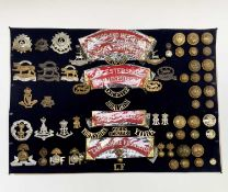 16th - 18th Foot. A display card containing cap badges, collar dogs, shoulder titles and buttons.