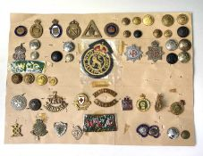 Military Auxiliary Services. A display card of badges, buttons, etc. Noted: On War Service, On War