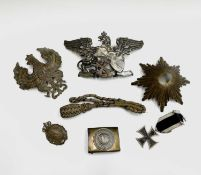 German Militaria. A small box containing mainly 1st World War German badges, etc. Lot includes an