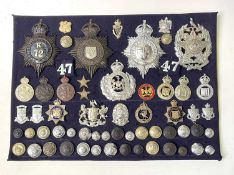 British Police Force Badges. A display card of badges, buttons and collar dogs including helmet