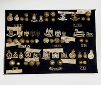 Dragoons - 2. A display card containing cap badges, collar dogs and buttons. Noted: 5th, 6th & 7th