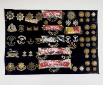 11th - 15th Foot. A display card containing cap badges, collar dogs, shoulder titles and buttons.
