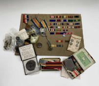 World War One Medals and Miscellaneous Military Items. Lot includes a 1914 Mons Star and Bar to