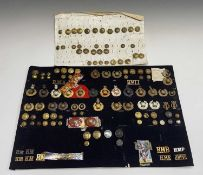 Royal Marines - 1. A cloth display of cap badges, collar dogs, shoulder titles and buttons. A