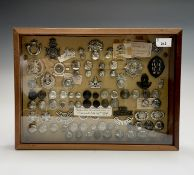 Volunteer Battallions. Comprising a board mounted framed and glazed display of badges, collar
