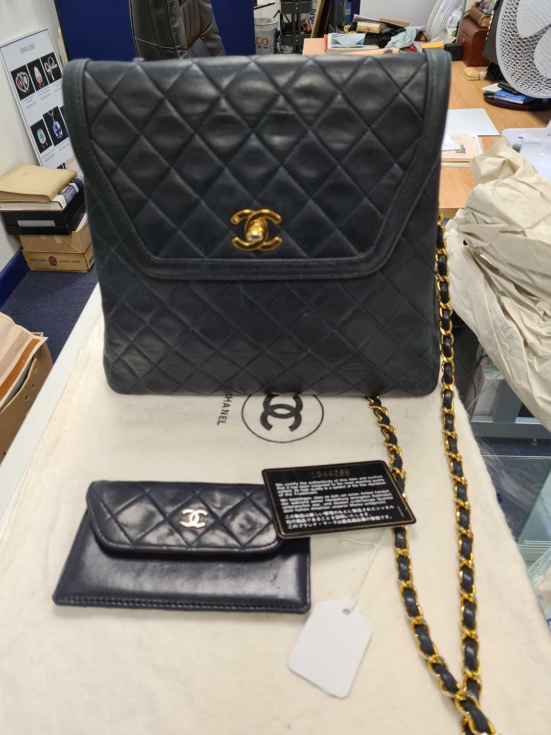 Chanel. A classic quilted leather handbag, of tapered square design, with gold tone CC logo clasp, - Image 26 of 26