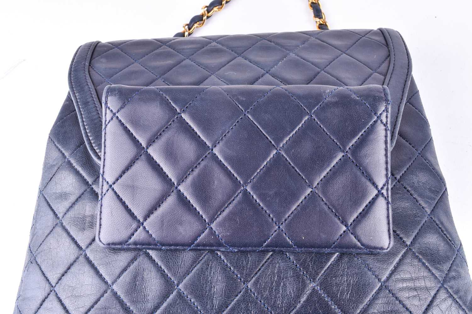 Chanel. A classic quilted leather handbag, of tapered square design, with gold tone CC logo clasp, - Image 8 of 26