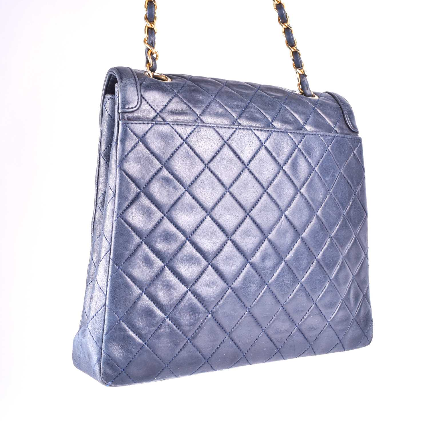 Chanel. A classic quilted leather handbag, of tapered square design, with gold tone CC logo clasp, - Image 13 of 26