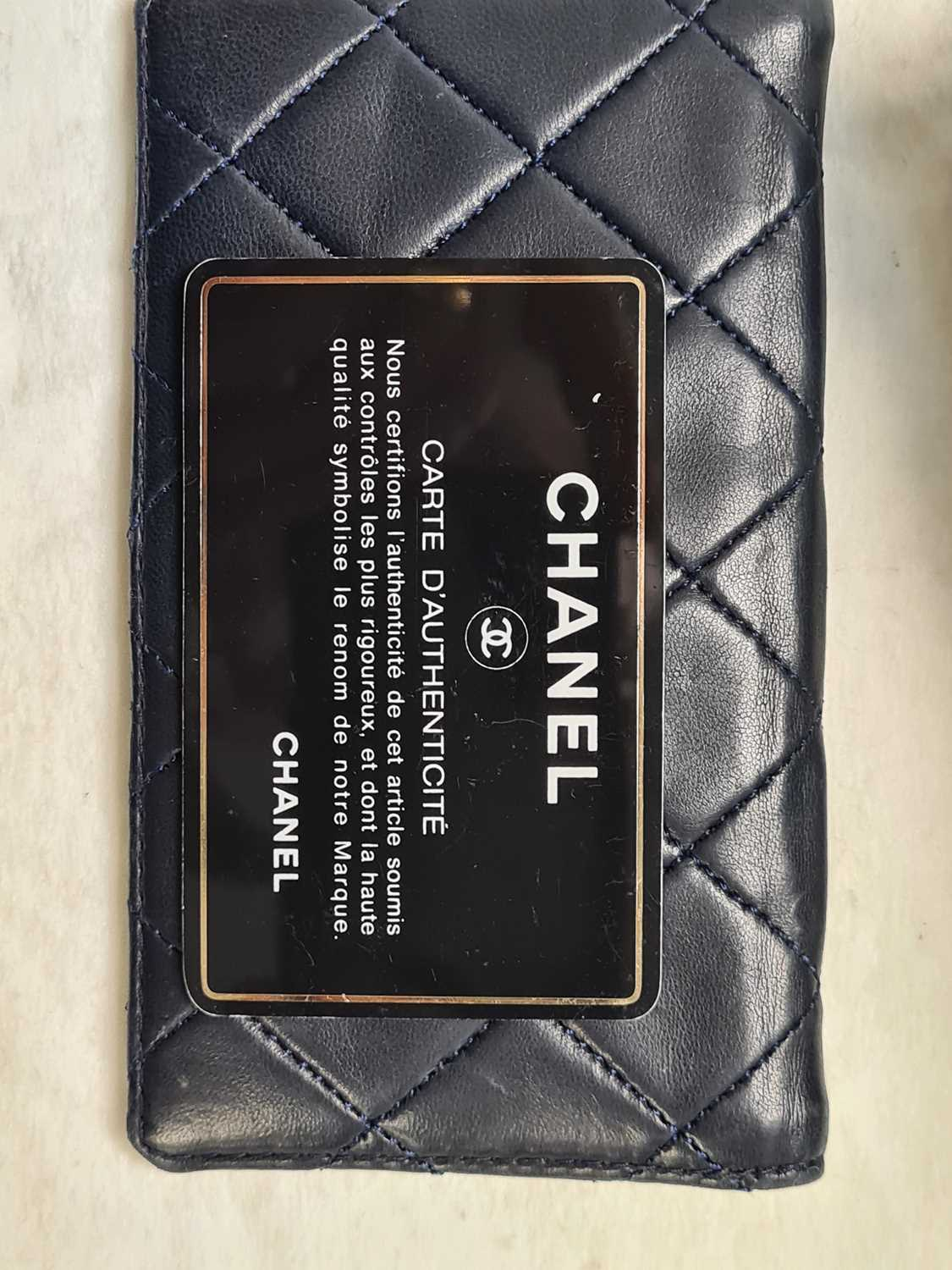 Chanel. A classic quilted leather handbag, of tapered square design, with gold tone CC logo clasp, - Image 21 of 26