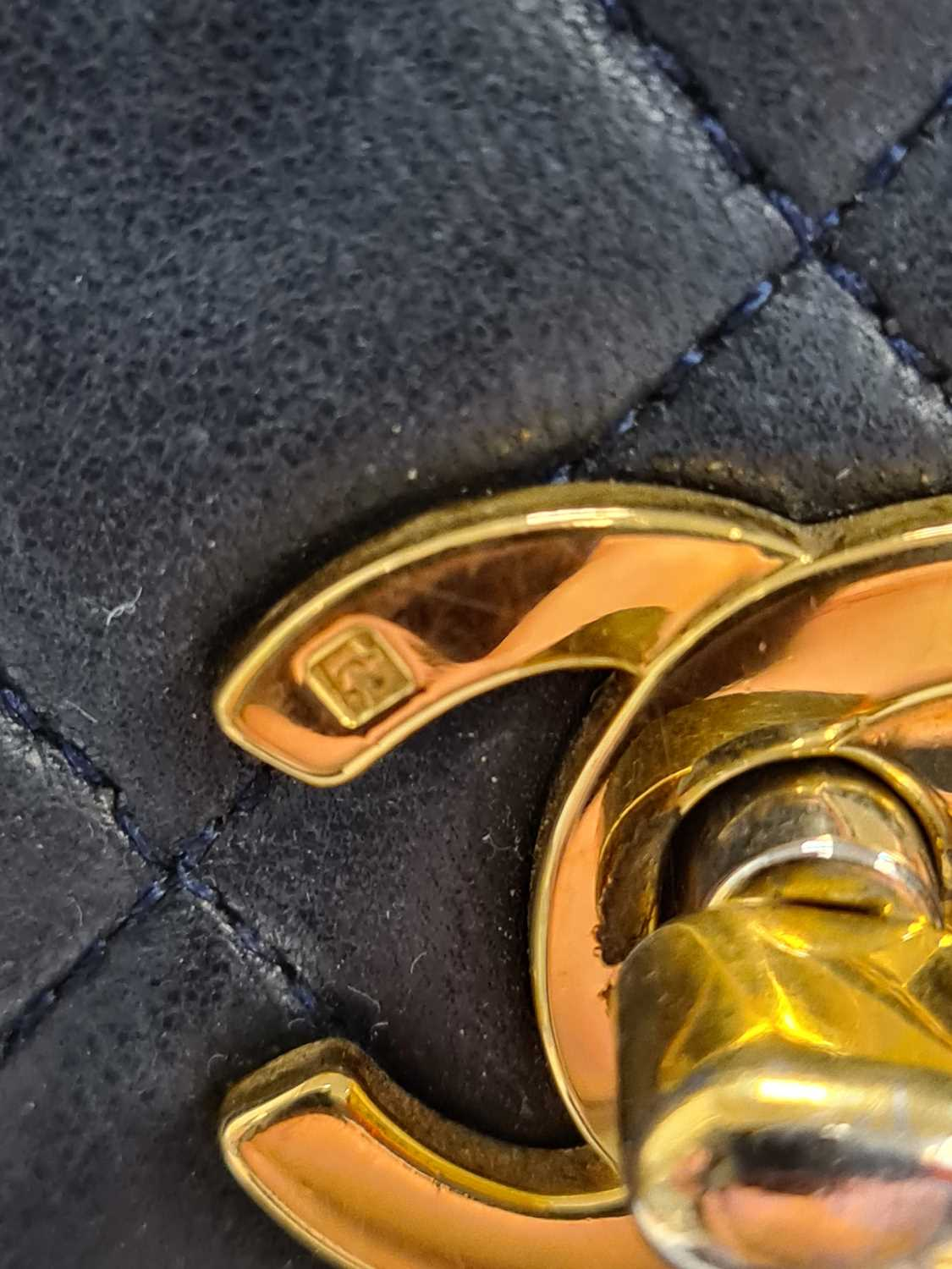 Chanel. A classic quilted leather handbag, of tapered square design, with gold tone CC logo clasp, - Image 25 of 26