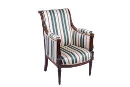 A French Empire style armchair, the mahogany frame with gilt metal embellishments, upholstered in