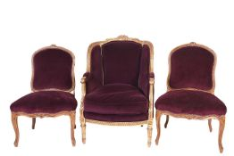 A French carved, gilded and upholstered armchair, late 19th/early 20th century, together with two