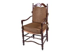 A Spanish walnut ladderback armchair, early 20th century, with ball finials and shaped back