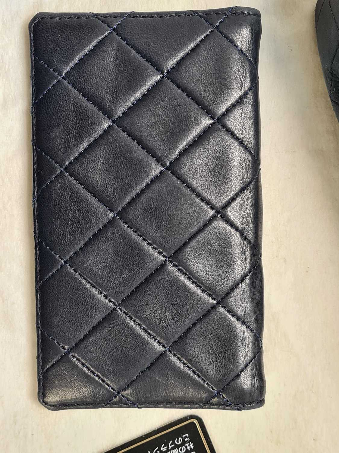 Chanel. A classic quilted leather handbag, of tapered square design, with gold tone CC logo clasp, - Image 20 of 26