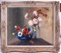 20th century school, a still life study of flowers in vases, oil on canvas, monogrammed 'EM', 62