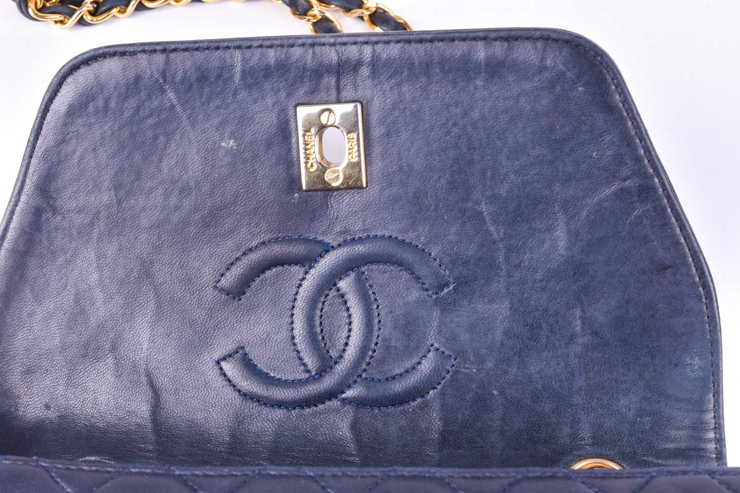 Chanel. A classic quilted leather handbag, of tapered square design, with gold tone CC logo clasp, - Image 4 of 26