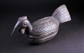 A Yoruba carved wood box in the form of a bird, Nigeria, with chip carved geometric band decoration,