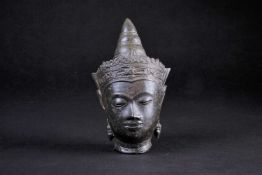 A Cambodian bronze bust of Buddha, 19th century, 15cmFootnote: From the collection of the late