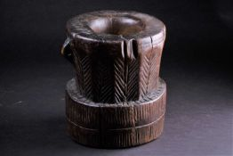 An Oromo carved wood mortar, Ethiopia, a single pierced lug to one side, with linear and diagonal