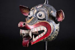 A Barong mask, Bali, Indonesia, hand carved and painted in black, red, white and yellow, pierced