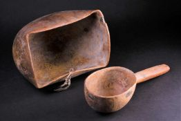 A Maasai hardwood bowl and scoop, Kenya, the bowl with round bottom and wide rectangular mouth, with