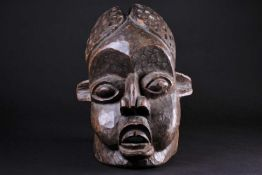 A Bamileke helmet mask, Cameroon, an elliptical opening to the crown of the elongated head, with