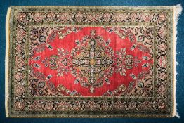 """A 20th century Qum, silk on silk rug with """"Book-Cover scheme on a plum red ground. Within cartouch"""