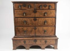 William & Mary walnut chest on stand. with crossbanded and quarter veneered top. Fitted two short
