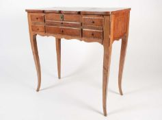 A Louis XVI style parquet line inlaid mahogany coiffeuse, with dressing mirror to the interior and