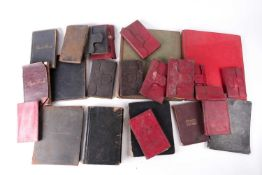 A collection of Victorian red, black Morocco leather-bound personal journals and ledgers of Henry