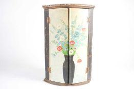 A Geo III two-door hanging cylinder corner cupboard now hand-painted corner cupboard by Jean de